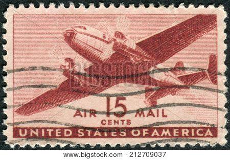 USA - CIRCA 1941: Postage stamp printed in USA shows Twin-motored Transport Plane circa 1941