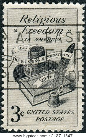 USA - CIRCA 1957: Postage stamps printed in USA Religious Freedom Issue dedicated to the 300th anniversary of the Flushing Remonstrance shows Bible Hat and Quill Pen circa 1957
