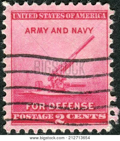 USA - CIRCA 1940: Postage stamp printed in the USA National Defense Issue shows a 90-millimeter Antiaircraft Gun circa 1940