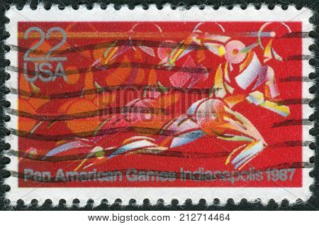 USA - CIRCA 1987: A postage stamp printed in the USA dedicated to the Pan American Games Indianapolis shows Runner in Full Stride circa 1987
