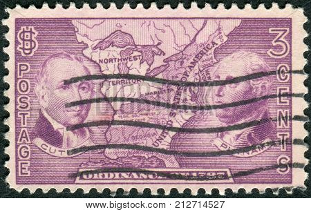 USA - CIRCA 1937: Postage stamp printed in the USA dedicated to the 150th anniversary of the adoption of the Ordinance of 1787 and the creation of the Northwest Territory shows Manasseh Cutler Rufus Putnam and Map of Northwest Territory circa 1937