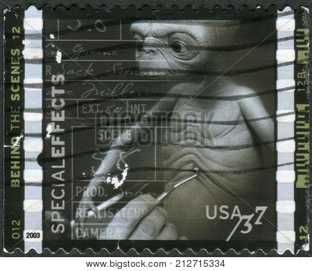 USA - CIRCA 2003: Postage stamp printed in the USA American Filmmaking: Behind the Scenes Special effects (Mark Siegel working on model for E.T. The Extra-Terrestrial) circa 2003
