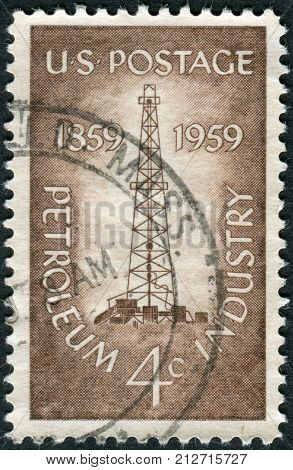 USA - CIRCA 1959: Postage stamp printed in the USA dedicated to the Centenary of the completion of the nation's 1st oil well at Titusville Pa. shows a Oil Derrick circa 1959