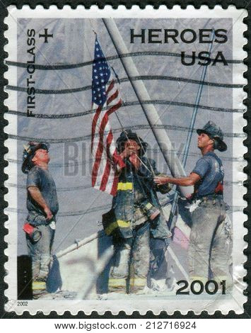 USA - CIRCA 2002: Postage stamp printed in the USA is dedicated to Heroes of the USA in 2001 depicts three firefighters raising the flag at Ground Zero New York circa 2002