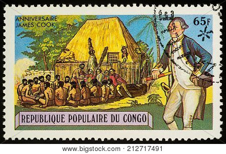 Moscow Russia - November 08 2017: A stamp printed in Congo shows Captain James Cook (1728-1779) and group of Polynesian men series