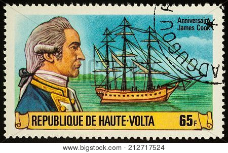 Moscow Russia - November 07 2017: A stamp printed in Upper Volta shows Captain James Cook and his ship Resolution series