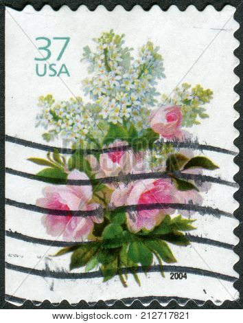USA - CIRCA 2004: Postage stamp printed in the USA shows flowers White Lilacs and Pink Roses circa 2004