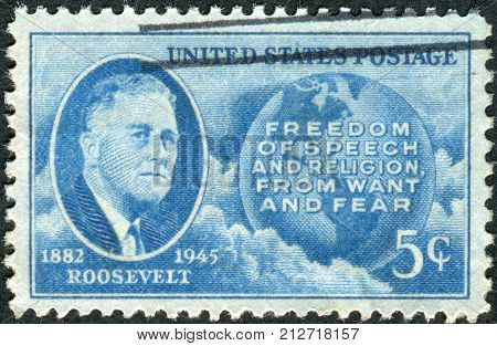 USA - CIRCA 1945: Postage stamp printed in the USA shows a portrait of 32th President of the United States Franklin Delano Roosevelt Globe and Four Freedoms circa 1945