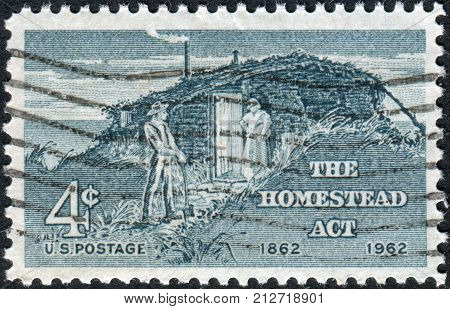 Usa - Circa 1962: Postage Stamp Printed In The Usa, Homestead Act Centenary, Shows Sod Hut And Settl