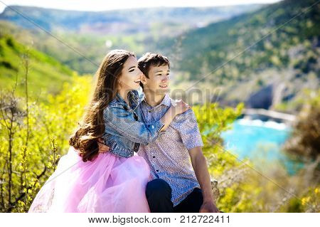 Beautiful love story on the lake. a beautiful young woman and her boyfriend are on the lake pond river and hugging, love story, after marriage, bright images, tenderness