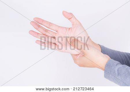 Asian woman massaging painful hand on a white background,Carpal Tunnel Syndrome from work