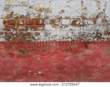 The Old Bright Decorative Stone Wall: A Dilapidated White Upper Part, Red Brick Is Visible In The Pl