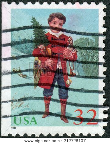 Usa - Circa 1995: Postage Stamp Printed In Usa, Christmas Issue, Shows A Child Holding A Christmas T