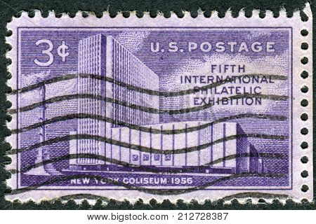 USA - CIRCA 1956: Postage stamp printed in the USA dedicated to the International Philatelic Exhibition FIPEX New York City shows the New York Coliseum and Columbus Monument circa 1956