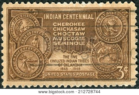 USA - CIRCA 1948: A postage stamp printed in the USA dedicated to the Centenary of the arrival in Indian Territory late Oklahoma of the Five Civilized Indian Tribes shows Map of Indian Territory and Seals of Five Tribes circa 1948