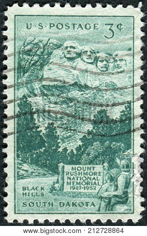 USA - CIRCA 1952: Postage stamp printed in the USA dedicated to the 25th anniversary of the dedication of the Mount Rushmore National Memorial shown Sculptured Heads on Mount Rushmore circa 1952