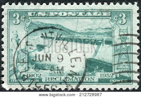 USA - CIRCA 1952: Postage stamp printed in the USA dedicated to the 50th anniversary of federal cooperation in developing the resources of rivers and streams in the West shows the Spillway Grand Coulee Dam circa 1952