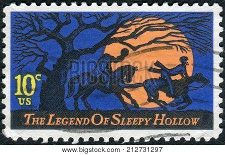 USA - CIRCA 1974: A postage stamp printed in USA Legend of Sleepy Hollow by Washington Irving. Design features Headless Horseman pursuing Ichabod Crane circa 1974