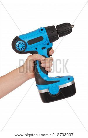 Hand holds cordless electric screwdriver with bit for screws isolated on white background