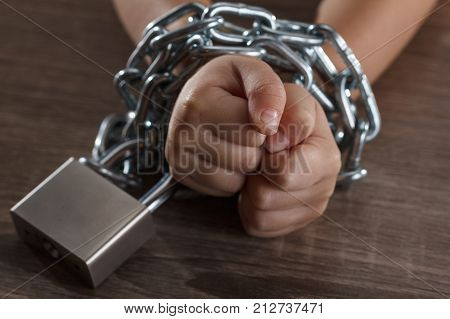 Children with chain tied imprison retarded Child Abuse on black abstract concept
