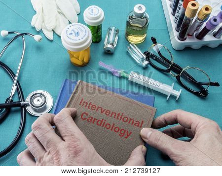 Doctor Holds Surgical Intervention Book, Conceptual Image