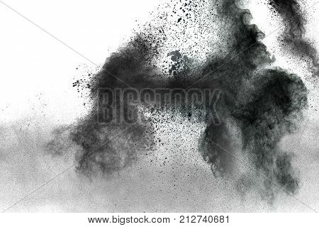 Abstract black powder explosion on white background. Black dust splash on white background.