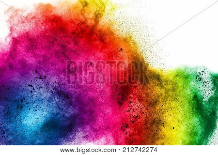 Explosion of colored powder on white background. Freeze motion of colorful splashed powder. Painted holi splattered.