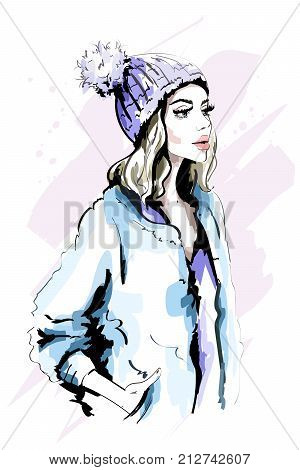 Beautiful young woman in knitted Hat with Fur Pom-Pom. Hand drawn stylish woman portrait. Fashion lady. Winter outfit. Sketch.