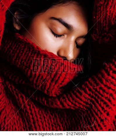 young pretty indian mulatto girl in red sweater posing emotional, fashion hipster teenage, lifestyle people concept close up