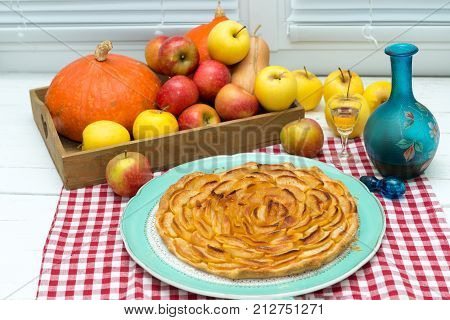 beautiful apple pie with apples and small glass of Calvados