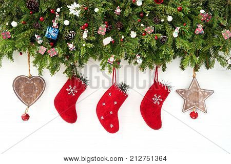 Christmas Background. Christmas Fir Tree With Christmas Socks On White Wooden Background. Copy Space