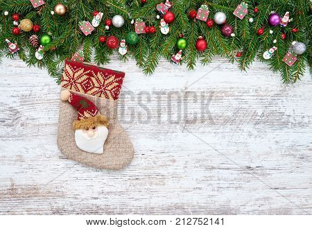Christmas Background. Christmas Fir Tree With Christmas Sock On Wooden Background, Copy Space.