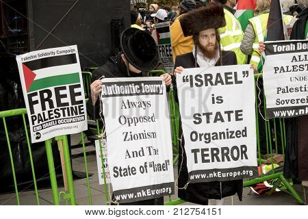 4th November 2017 London United Kingdom:-Jewish men protesting Israel at a pro Palestine rally in Parliment Square