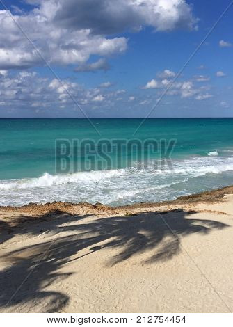 Beautiful view of the ocean. Waves and white sand. Atlantic coast of Cuba. Varadero