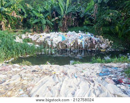 Bag laundry in stream for informal recycling in Santo Domingo, Dominican Republic