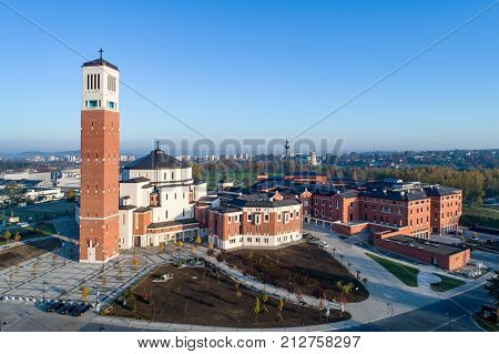 Sanctuary church and information center commemorating activity of Pope John Paul II. Lagiewniki Krakow Poland. Aerial view. Divine Mercy Church and St Faustina sanctuary in the background