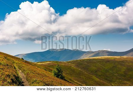 Mountain Ridge Behind The Rolling Hills