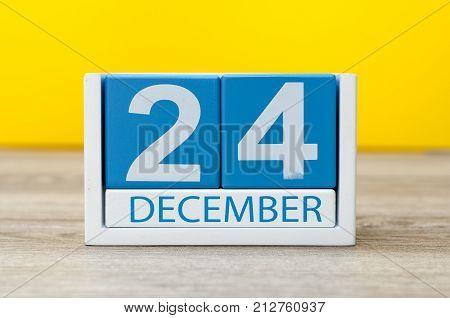Eve, Christmas. December 24th. Day 24 of december month, calendar on light background. Winter time season.