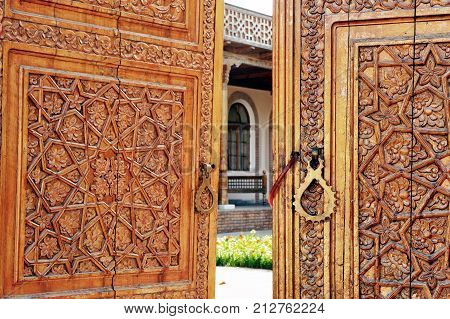 Samarkand: the open wooden gates to madrasah