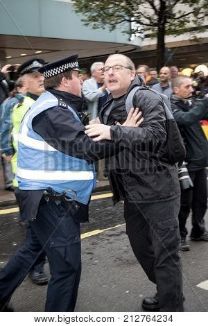 4th November 2017 London United Kingdom:-Unidentified protester scuffles with a police officer at a pro Palestine rally