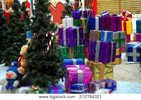 Huge Pile Of Christmas Presents And Christmas Trees In A Shopping Mall Ready For The Holiday Season