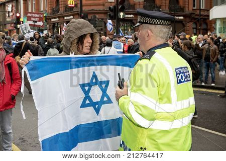 4th November 2017 London United Kingdom:-Pro Israeli protester confronts a metropolitan police officer at a pro Palestine rally