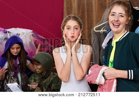 Theater Assistant Laughs As Actress Pouts At Camera