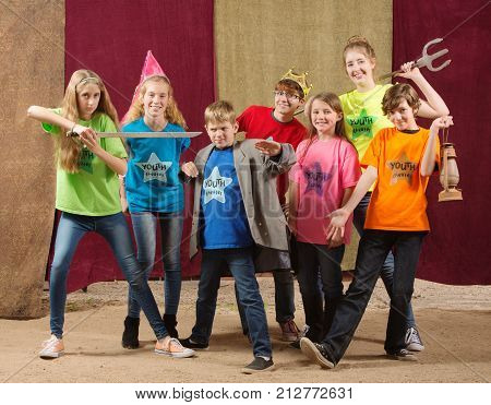 Young Actors Pose Together With Sword