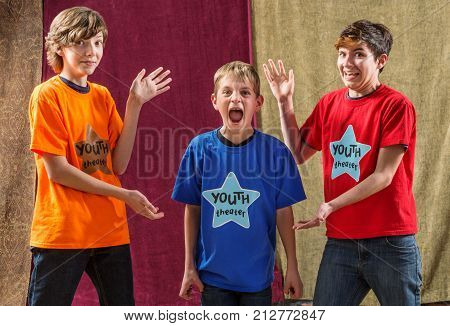 Young actor screams as his two friends pose for the camera on either side of him