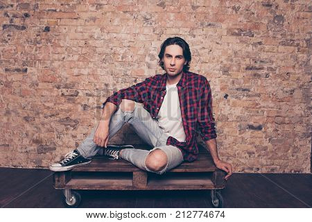 Full Length Close Up Of Young Successful Freelancer Student On The Brick Stones Wall Background, Sit