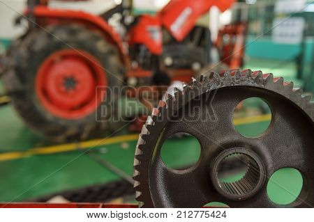 tractor part of the combine at the plant awaits assembly tractors and agricultural machinery maintenance and exports.