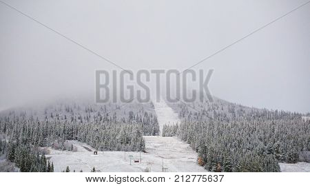 Snow And Clouds Obscure The View On The Mountain Hovaerken In Sweden