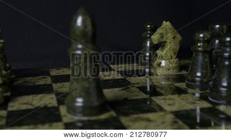 Ghess White Horse Defeats Black Pawn. Selective Focus. Chess, Horse And Pawn. Details Of Chess Piece