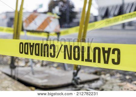 Caution cuidado tape around a work construction area